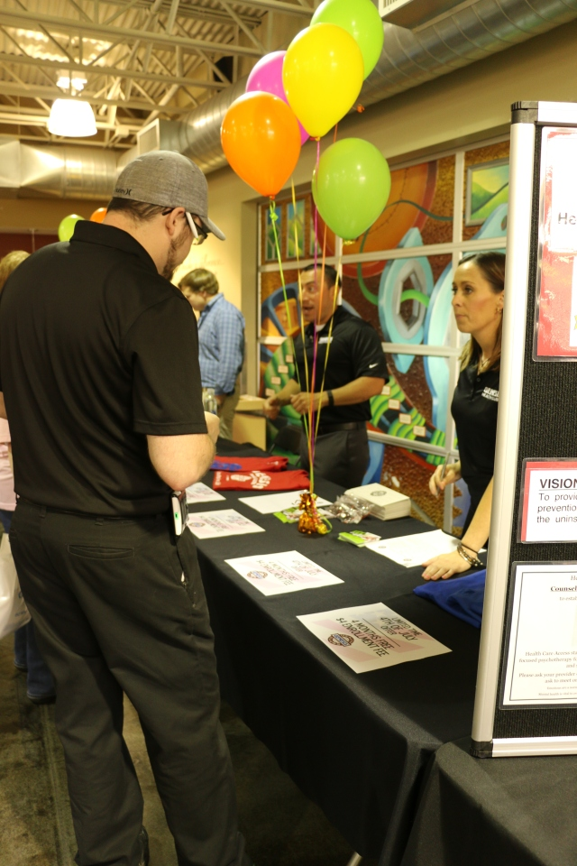 Entrematic Team Member Luke Whittmore at the Genesis Health Club booth